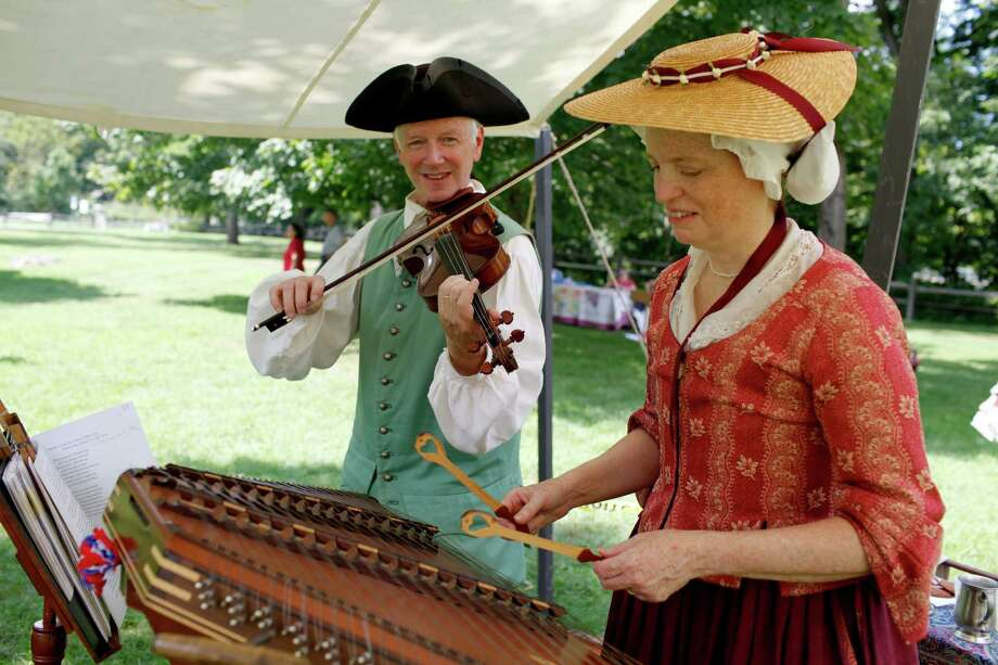 Colonial Balladeers Ridley Enslow plays a fiddle made in 1776, while his wife Anne plays the hammered dulcimer, during 18th Century Day at the Historic Schuyler House on Sunday Aug. 12, 2012 in Schuylerville, N.Y. (Dan Little/Special to the Times Union) Photo: Dan Little / Dan Little