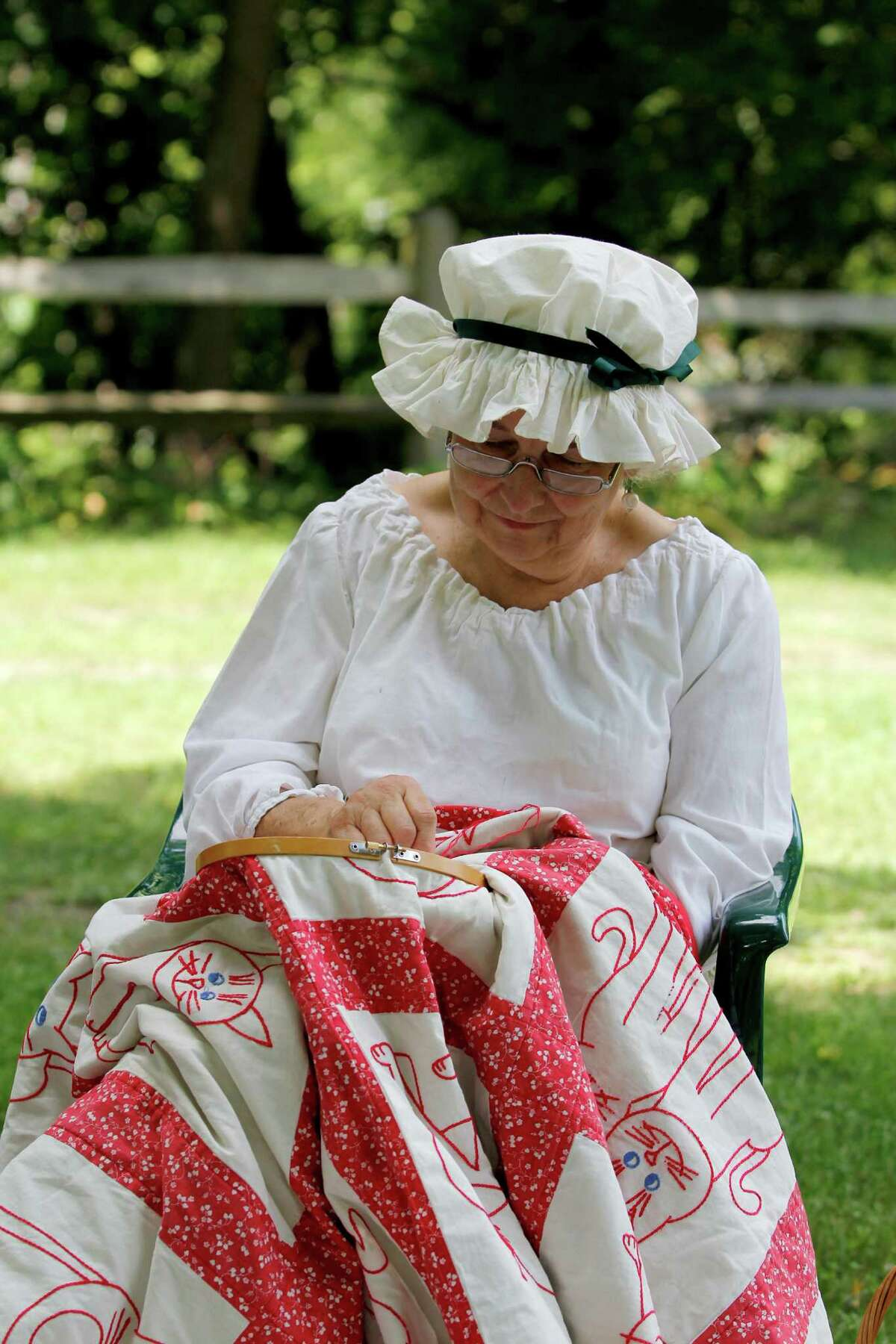 Gay Gamage of Saratoga repairs the embroidering on a quilt during 18th Century Day at the Historic Schuyler House on Sunday Aug. 12, 2012 in Schuylerville, N.Y. (Dan Little/Special to the Times Union)