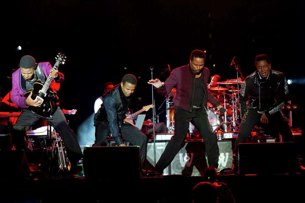 Tito, from left to right, Jackie, Marlon and Jermaine Jackson perform during The Jacksons: Unity Tour 2012, part of the Seaside Summer Concert Series on Saturday, Aug. 11, 2012 in Brooklyn, New York.