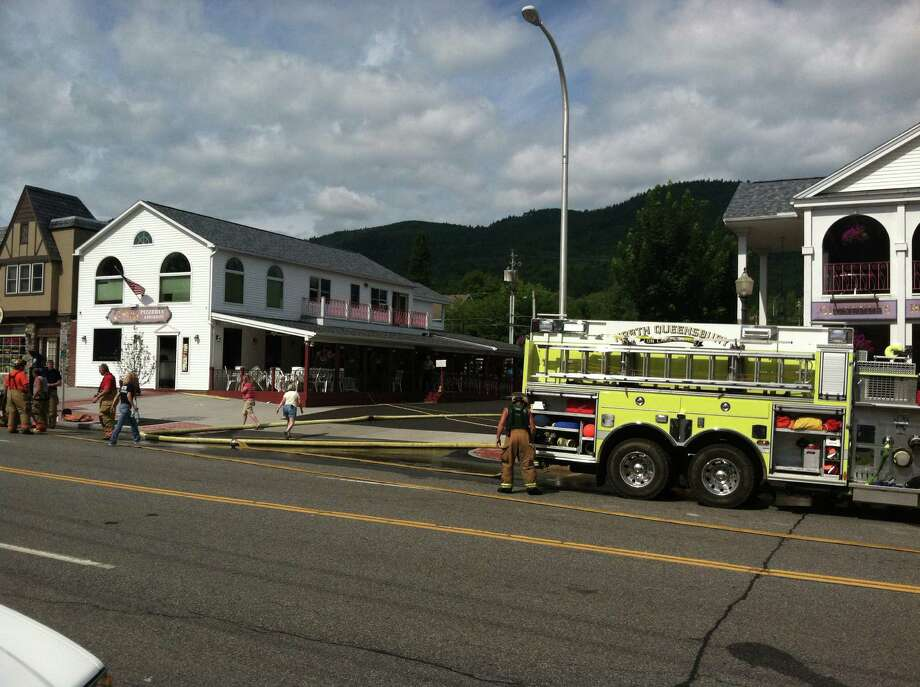 Fire departments made quick work of a fire at Giuseppi's Pizzeria on Canada Street in Lake George, N.Y. Aug 13, 2012. (Skip Dickstein / Times Union) Photo: Skip Dickstein Times Union