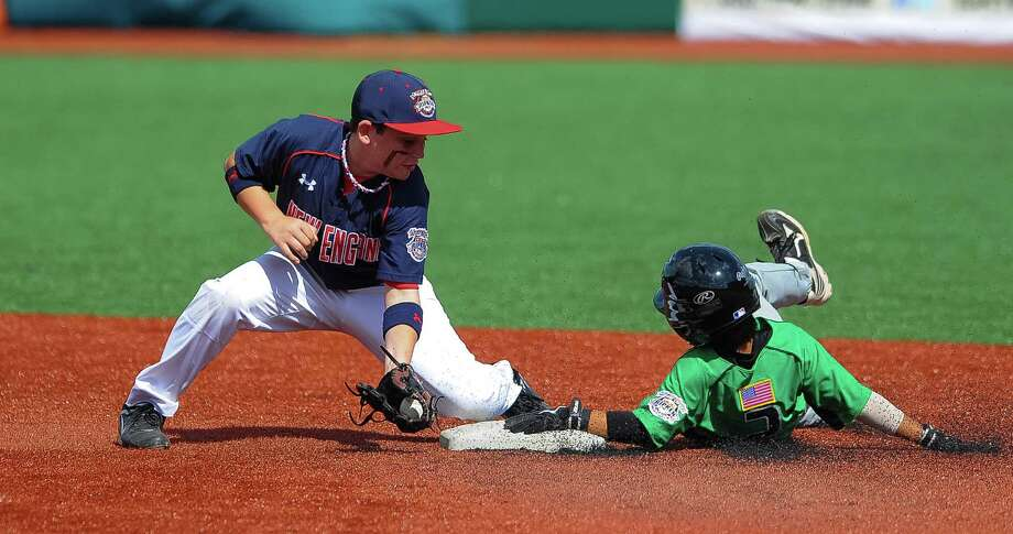 Newtown(CT)'s Lucas O'Brien tries to put a tag on Mililani(HI)'s Shea Yamaguchi as he steals second base during the Cal Ripken Babe Ruth World Series in Aberdeen, Maryland on August 12, 2012 Photo: Scott Serio, Zumapress.com / Eclipse Sportswire Inc. (Eclipse or ESW).All Rights Reserved.contact: EclipseSportswire@gmail.com.http://www.EclipseSportswire.c