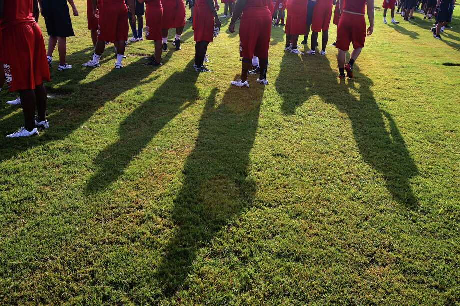 8/13/12: The sun cast long shadows early in the morning while the Dawson High School 4A  football team practices at Dawson High School in Pearland, Texas.   For the Chronicle: Thomas B. Shea Photo: Thomas B. Shea, For The Chronicle / © 2012 Thomas B. Shea