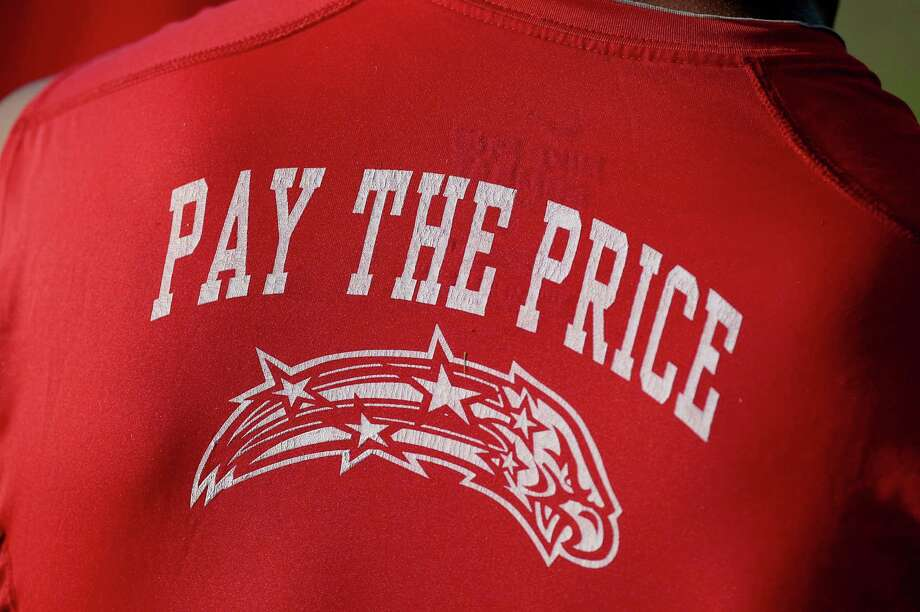 """8/13/12: The moto this year for Dawson HS football is """"Pay The Price"""". Members of the Dawson High School 4A  football team practices at Dawson High School in Pearland, Texas.   For the Chronicle: Thomas B. Shea Photo: Thomas B. Shea, For The Chronicle / © 2012 Thomas B. Shea"""