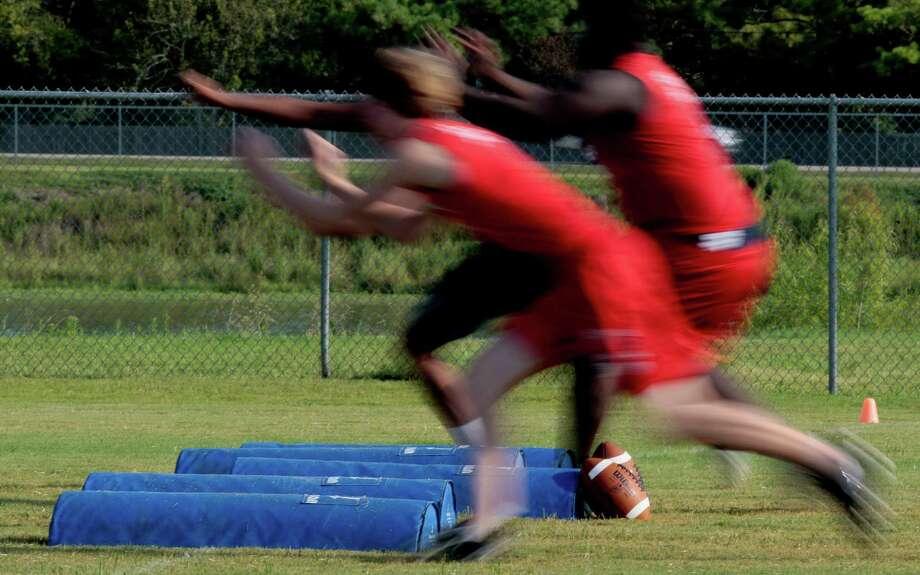 8/13/12: The Dawson High School 4A  football defensive team practice at Dawson High School in Pearland, Texas.   For the Chronicle: Thomas B. Shea Photo: Thomas B. Shea, For The Chronicle / © 2012 Thomas B. Shea