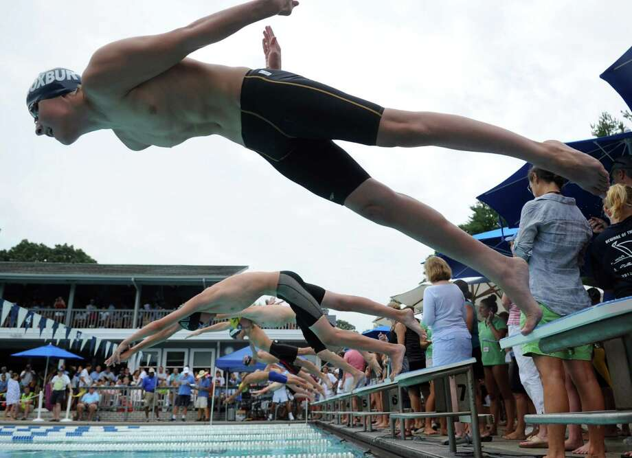 Phillip Zyskowski of Roxbury Swim and Tennis Club dives off the block to compete in the boys 14 and under 100 SC meter individual medley during the Fairfield County Swim League Championshps at Roxbury Swim and Tennis Club in Stamford on Saturday, August 11, 2012. Photo: Lindsay Niegelberg / Stamford Advocate