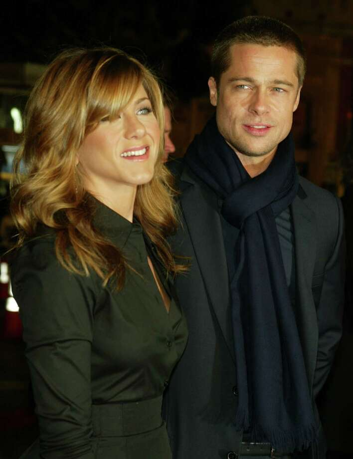 "Aniston and Pitt attend the Los Angeles premiere of Universal Pictures' film ""Along Came Polly"" at the Grauman's Chinese Theater Jan. 12, 2004 in Hollywood. Photo: Kevin Winter, Getty / 2004 Getty Images"