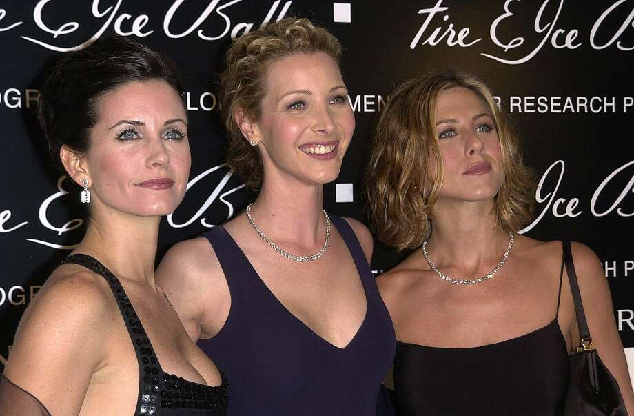 Cox, Kudrow and Aniston pose after arriving at the 10th Annual Fire & Ice Ball Dec. 11, 2000, in Beverly Hills, Calif.   AFP PHOTO/VINCE BUCCI Photo: Vince Bucci, Getty / AFP