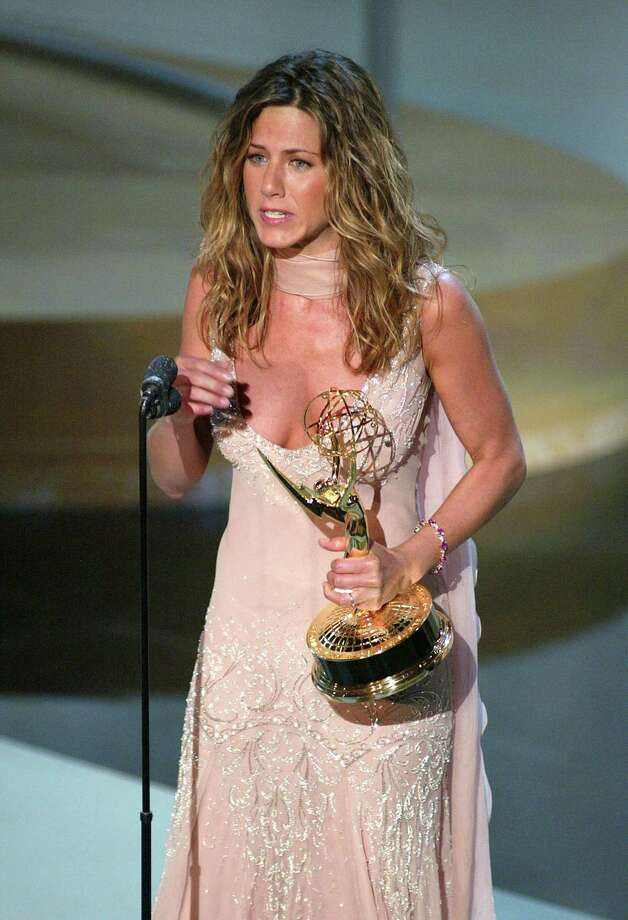 """Aniston accepts the award for """"Outstanding Lead Actress in a Comedy Series"""" for """"Friends"""" at the 54th Annual Prime Time Emmy Awards at the Shrine Auditorium in Los Angeles on Sept. 22, 2002, Photo by Frank Micelotta/Getty Images. Photo: Frank Micelotta, Getty / ImageDirect"""