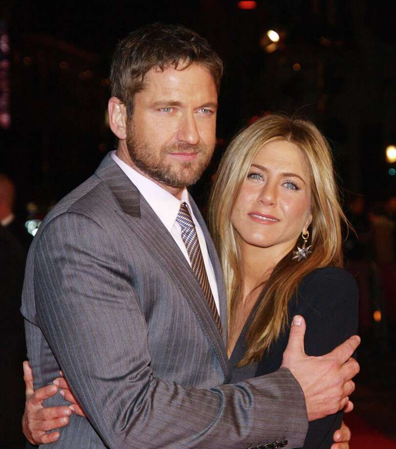 Aniston poses with her co-star Gerard Butler as they arrive for the Gala Premiere of their latest film, 'The Bounty Hunter ' in London's Leicester Square, on March 11, 2010. AFP PHOTO/MAX NASH Photo: MAX NASH, Getty / 2010 AFP