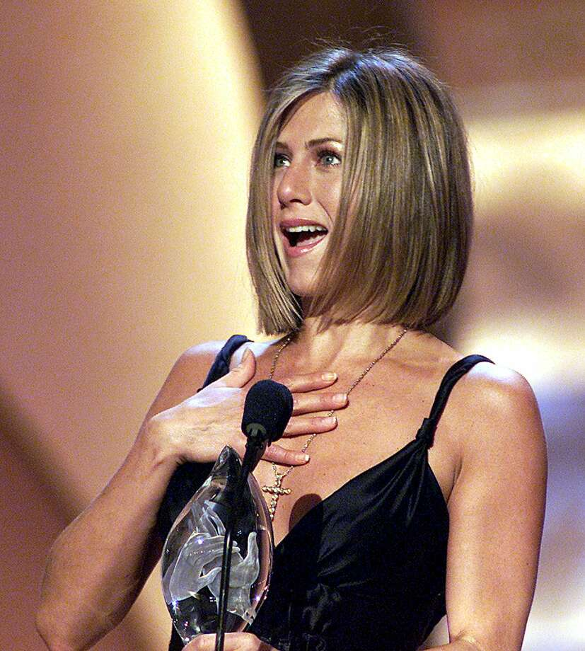 "Aniston accepts her People's Choice Award for ""Favorite Female Television Performer"" during the 27th Annual People's Choice Awards on Jan. 7, 2001, in Pasadena, Calif. AFP Photo  Lucy NICHOLSON/ Photo: LUCY NICHOLSON, Getty / AFP"