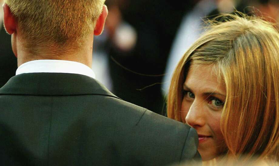 "Pitt and Aniston attend the World Premiere of epic movie ""Troy"" at Le Palais de Festival on May 13, 2004, in Cannes, France. Photo: Bruno Vincent, Getty / 2004 Getty Images"