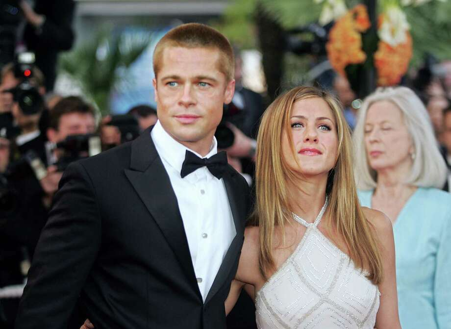 "Pitt and Aniston arrive for the official projection of  ""Troy"" on May 13, 2004, at the 57th Cannes Film Festival. AFP PHOTO/BORIS HORVAT Photo: BORIS HORVAT, Getty / 2004 AFP"