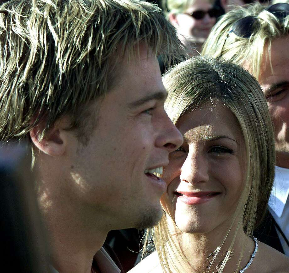 Aniston poses with her husband Brad Pitt during the arrivals to the  52nd Annual Prime Time Emmy Awards at the Shrine Auditorium in Los Angeles on Sept. 10, 1999.   AFP PHOTO   Scott NELSON/mn Photo: Scott Nelson, Getty / AFP