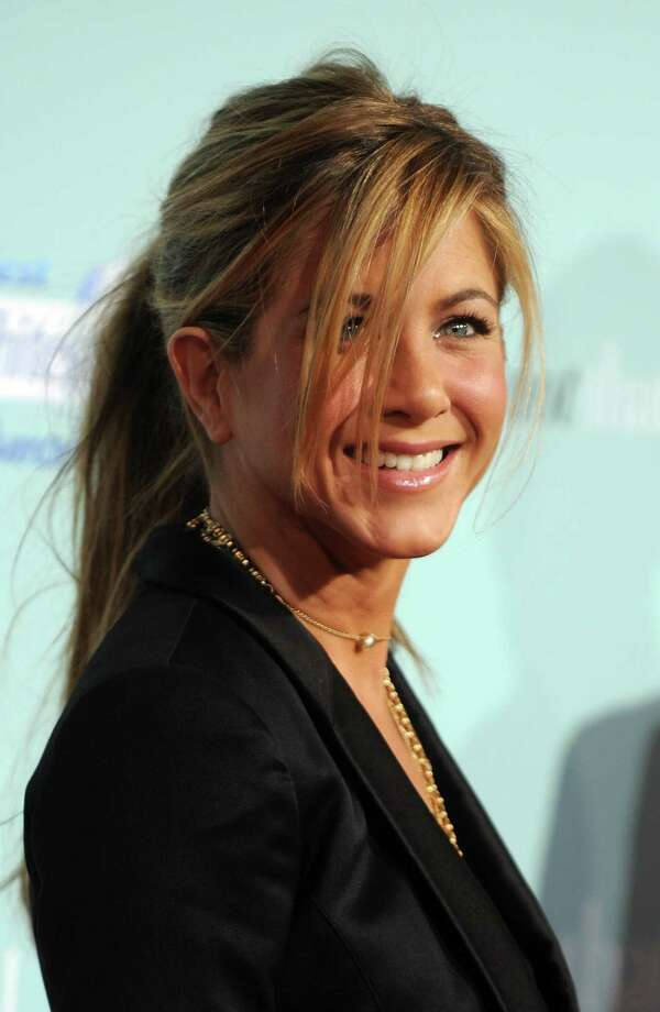 "Aniston arrives for the world premiere of ""He's Just Not That Into You"" at the Grauman's Chinese Theater in Hollywood on Feb. 2, 2009.  AFP PHOTO / GABRIEL BOUYS Photo: GABRIEL BOUYS, Getty / 2009 AFP"