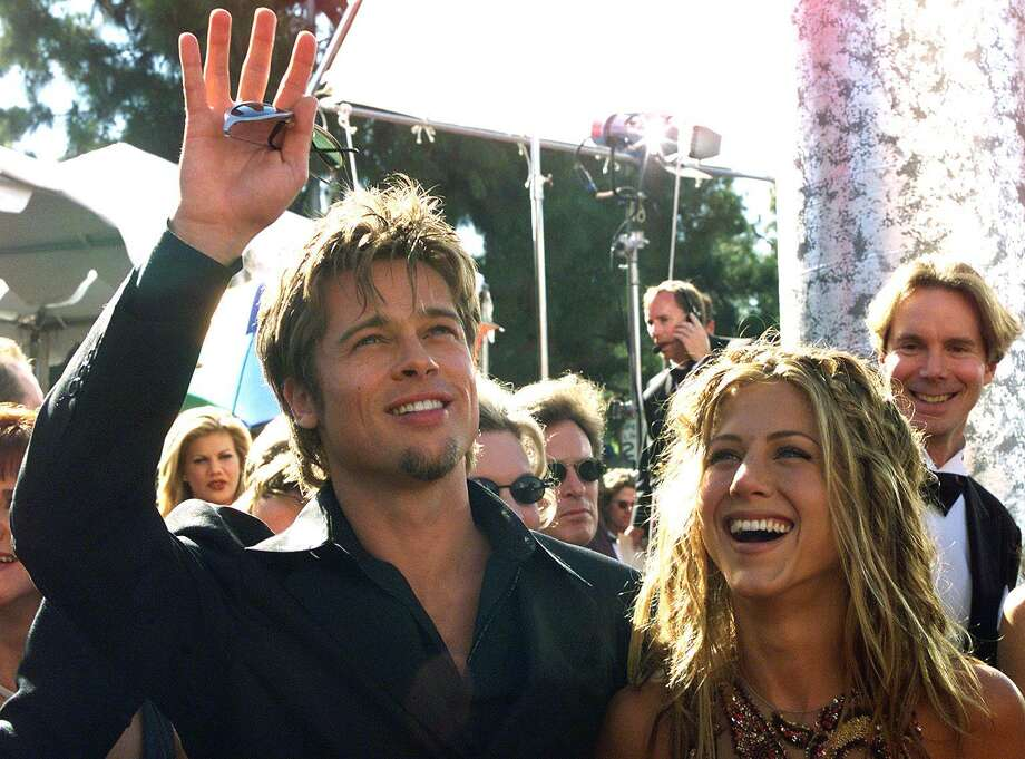 Pitt waves to spectators as he arrives with Aniston at the Shrine Auditorium in Los Angeles, Calif., on Sept. 12, 1999.    AFP PHOTO/ Hector MATA Photo: HECTOR MATA, Getty / AFP