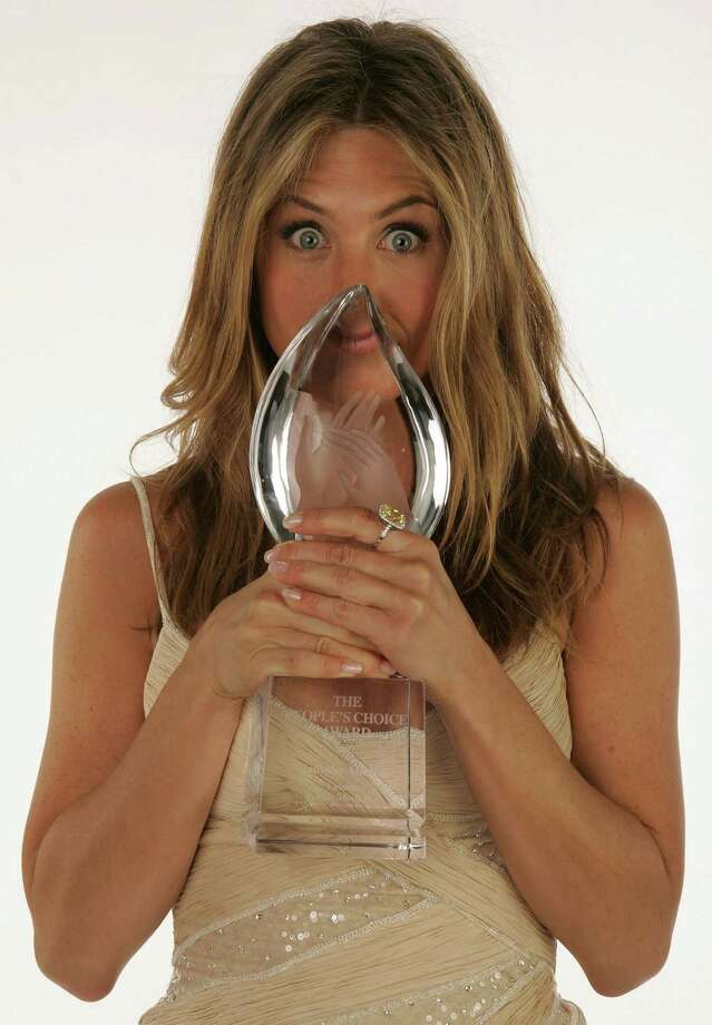 Aniston poses in the portrait studio with her Favorite Female Movie Star Award during the 33rd Annual People's Choice Awards held at the Shrine Auditorium on Jan. 9, 2007, in Los Angeles. Photo: Mark Mainz, Getty / 2007 Getty Images