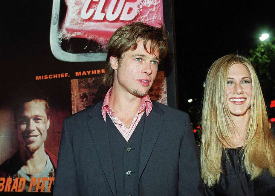 "Pitt arrives at the premiere of his new film ""Fight Club"" with Aniston in Los Angeles, Calif., on Oct. 6, 1999. Photo: LUCY NICHOLSON, Getty / AFP"