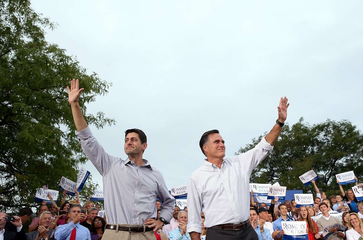 WAUKESHA, WI - AUGUST 12: Republican presidential candidate and former Massachusetts Governor Mitt Romney (R) and his running mate Rep. Paul Ryan (R-WI) greet supporters during a homecoming campaign rally at the Waukesha County Expo Center on August 12, 2012 in Waukesha, Wisconsin. Mitt Romney continues his four day bus tour a day after announcing his running mate, Rep. Paul Ryan (R-WI). (Photo by Justin Sullivan/Getty Images) *** BESTPIX *** (Getty Images)