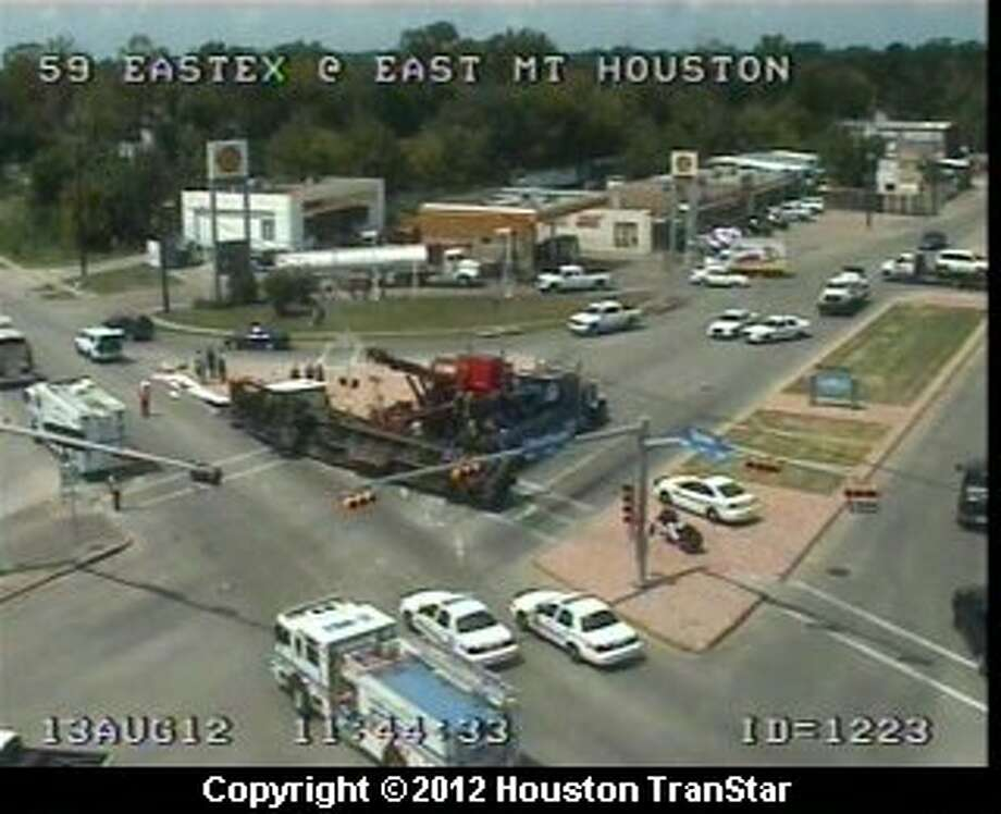 A wreck involving an overturned 18-wheeler blocked portions of the southbound Eastex Freeway frontage road near Mt. Houston Monday morning. Photo: Houston Transtar
