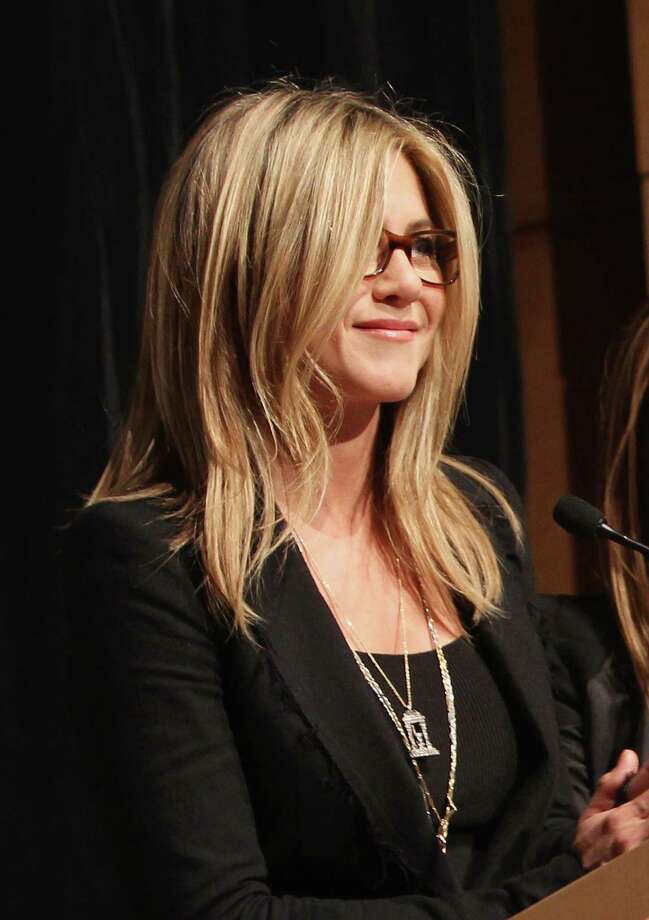 "Aniston speaks during the red carpet screening in the nation's capitol for the TV movie event ""Five"" hosted by Lifetime and Jennifer Aniston at Ronald Reagan Building and International Trade Center on Oct. 3, 2011 in Washington, DC. Photo: Paul Morigi, Getty / 2011 Getty Images"