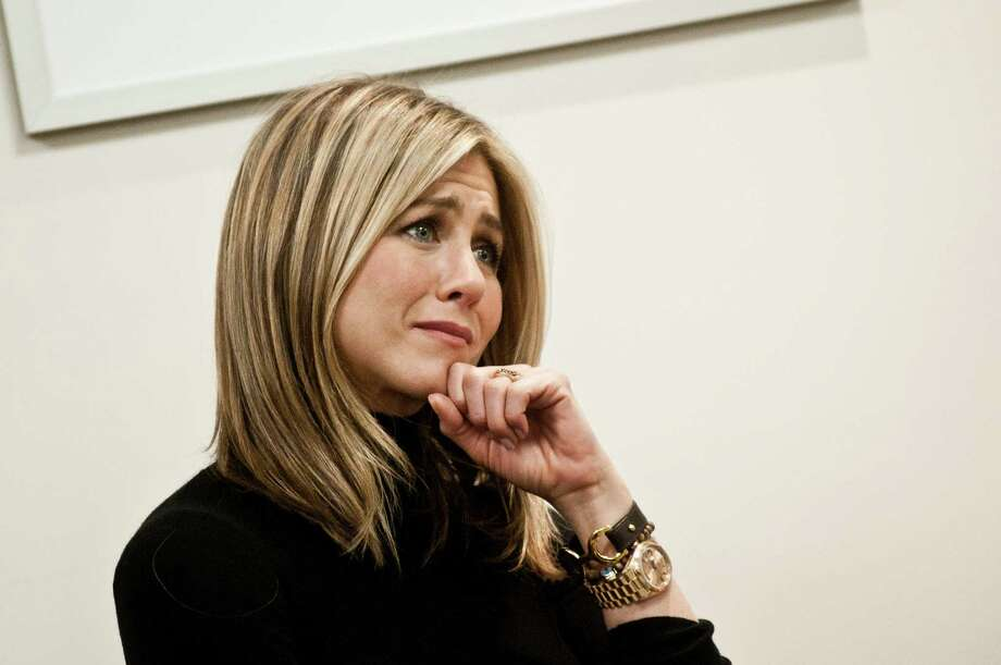 Aniston listens during a roundtable discussion during a visit to the Breast Care Center at the Inova Alexandria Hospital at Mark Center on Oct. 3, 2011, in Alexandria, Va. Photo: Kris Connor, Getty / 2011 Getty Images