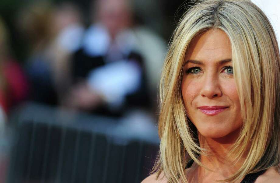 "Actress Jennifer Aniston arrives for the Los Angeles premiere of ""Horrible Bosses,"" June 30 2011. at Grauman's Chinese Theater in Hollywood. AFP PHOTO / Robyn BECK Photo: ROBYN BECK, Getty / 2011 AFP"