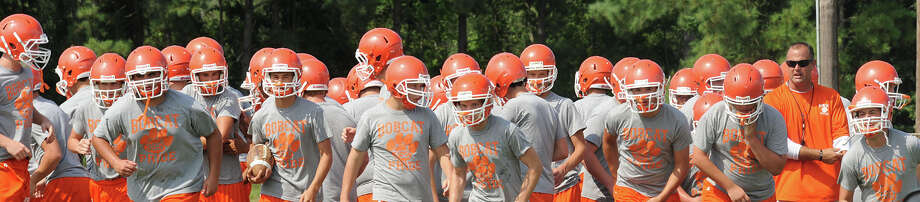 Orangefield players met on the school's practice field Thursday to drill plays and ready the team to play East Chambers at the Buccaneers' stadium on August 31. Photo taken Thursday, July 9, 2012 Guiseppe Barranco/The Enterprise Photo: Guiseppe Barranco, STAFF PHOTOGRAPHER / The Beaumont Enterprise