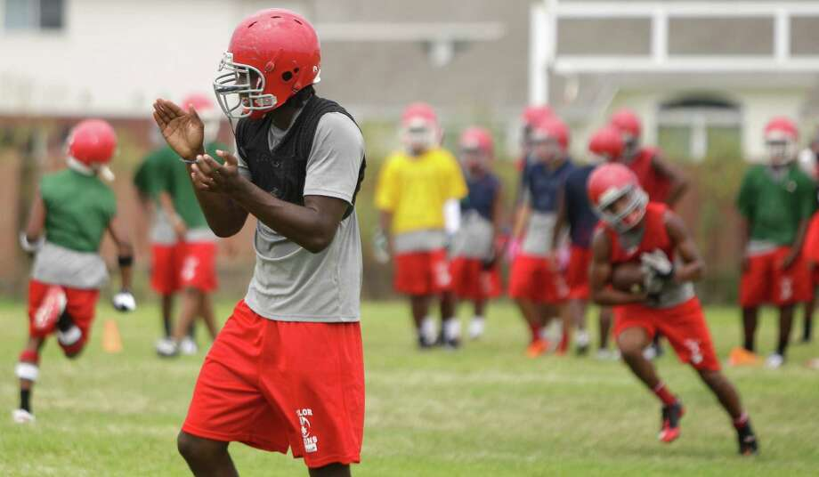 Alief Taylor High School football player Torrodney Prevot claps as he and other players run drills during first day of practice Monday, Aug. 13, 2012, in Houston. Photo: Melissa Phillip, Houston Chronicle / © 2012 Houston Chronicle