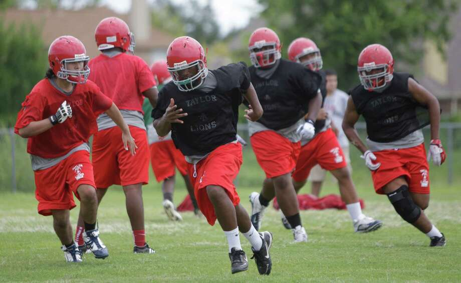 Alief Taylor High School football players run drills during first day of practice Monday, Aug. 13, 2012, in Houston. Photo: Melissa Phillip, Houston Chronicle / © 2012 Houston Chronicle
