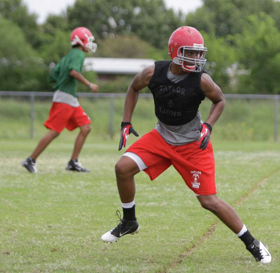 Alief Taylor High School football player Jonathan Wiggins runs a play  during first day of practice Monday, Aug. 13, 2012, in Houston. Photo: Melissa Phillip, Houston Chronicle / © 2012 Houston Chronicle