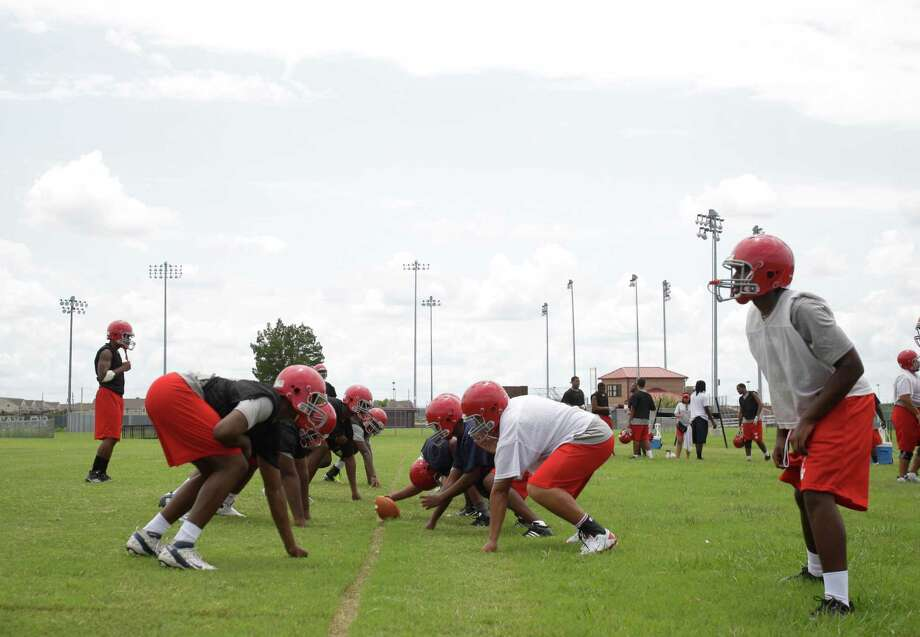 Alief Taylor High School football players run plays during first day of practice Monday, Aug. 13, 2012, in Houston. Photo: Melissa Phillip, Houston Chronicle / © 2012 Houston Chronicle