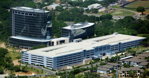 Tesoro Corporation's 618,000 square foot headquarters building, located in RidgeWood Park, a 122-acre master-planned business community, is seen in this April 10, 2012 aerial photo. Photo: William Luther, San Antonio Express-News / © 2012 WILLIAM LUTHER
