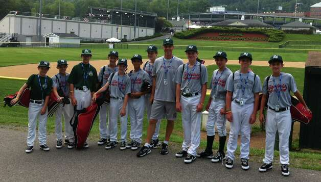 Fairfield American's Little League team  in Williamsport, Pa. Monday posed against the backdrop of Lamade Stadium in the Little League complex. From left are Kevin Oricoli, Matty Clarkin, Will Lucas, Henry Prestegaard, Ryan Meury, Michael Ghiorzi, Matt Kubel, manager Bill Meury, Patrick Steed, Biagio Paoletta, Dan Kiernan and Chris Meyers Photo: Contributed Photo / Fairfield Citizen contributed
