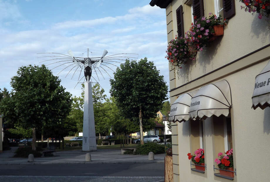 The Gustav Weisskopf Memorial includes an exact replica of Gustave Whitehead' s plane, which some people believe Whitehead flew half a mile in Bridgeport on Aug. 14, 1901. The memorial stands near the bus stop in Leutershausen, Germany. Photo: Tim Loh / Connecticut Post