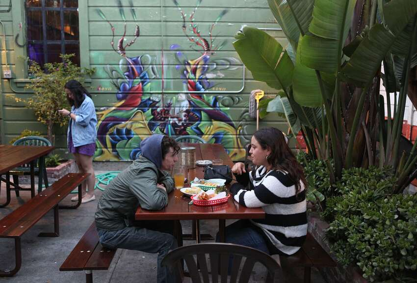 The outside eating area of the Broken Record kitchen . (Liz Hafalia / The Chronicle)