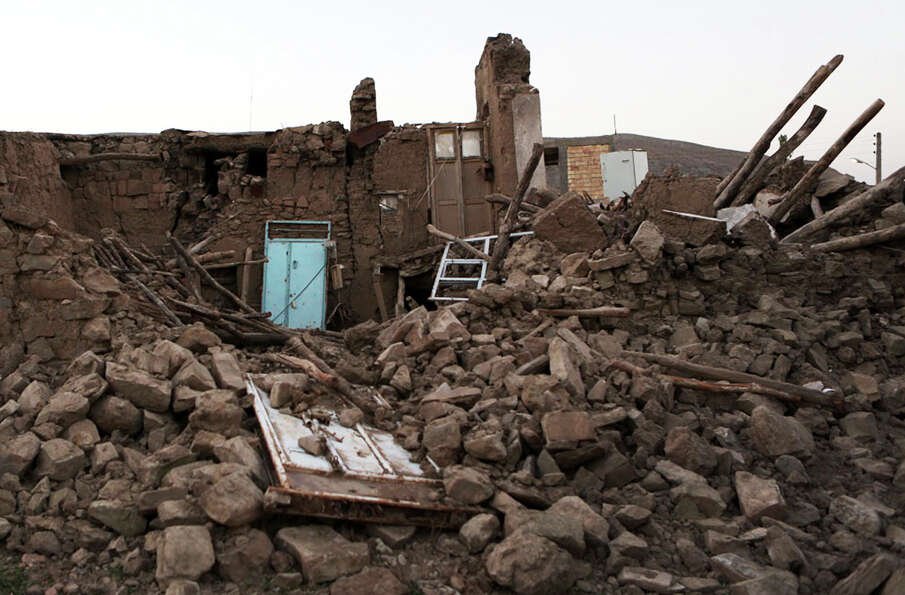 Ruins of a buildings are seen after an earthquake hit a village near the city of Varzaqan in northwe