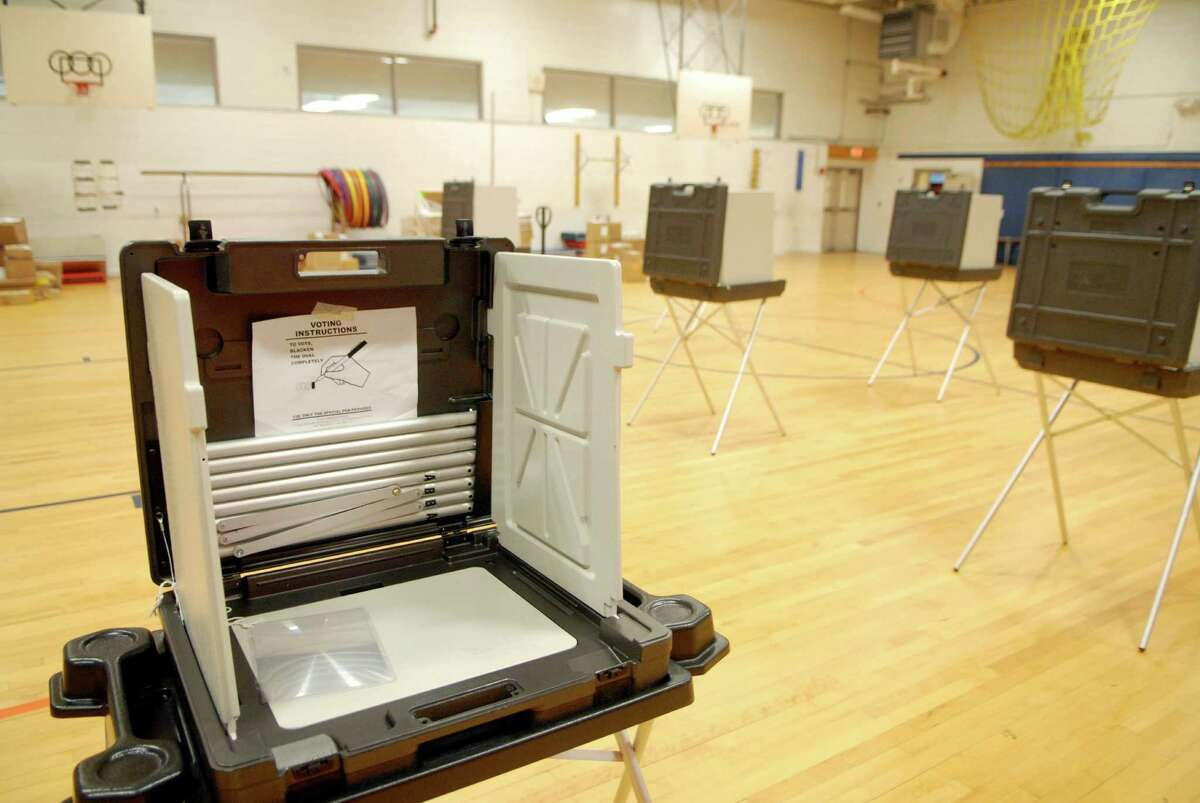 Voting machines are set up at Stark School in Stamford, Conn. on Monday August 13, 2012 for Tuesday's primary.