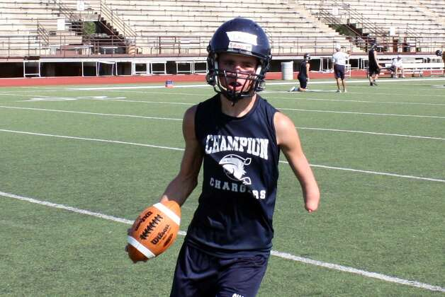 Boerne Champion junior receiver/defensive back Daniel Lang has impressed coaches and teammates with his hard work and ability to make plays even though he was borne with virtually no left arm below the elbow. Photo: Picasa, Mike Reeder / For The Northwest