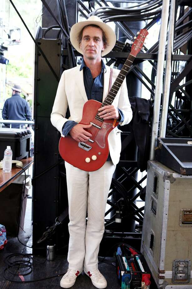 """Who:Sean Hayes is a singer songwriter based in San Francisco who performed songs from his forthcoming album """"Before we turn to Dust."""" Wearing: White linen suit by Band of Outsiders, Soda & Scotch shirt, New Balance white sneakers, burgundy socks and Panama hat made in Yucatan Mexico. Philosophy: """"Someone said I look like a preacher from the south in this suit. I am going to do a bit of singing and preaching about love and family."""" (Sarah Adler)"""