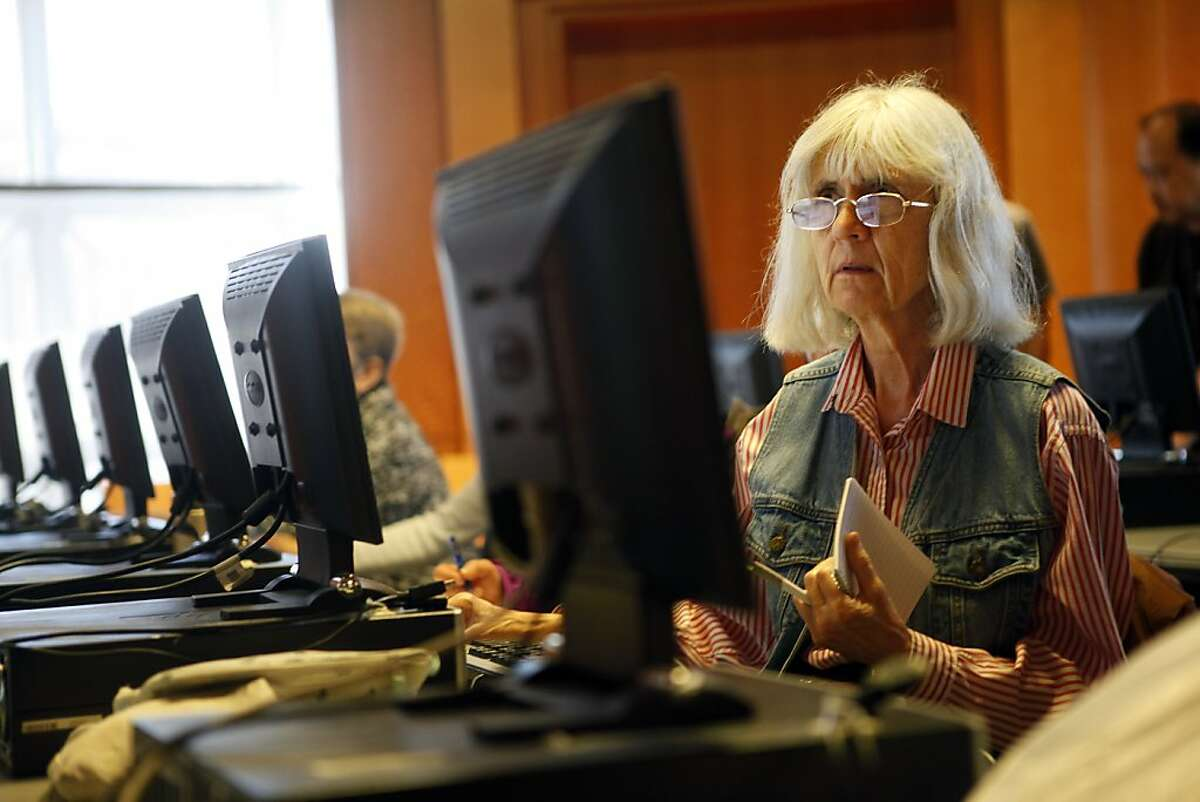 Linda Longmann, who has a Kindle, takes part in a class this month at San Francisco's Main Library that taught patrons how to use their electronic readers to check out and read books from the library's collection.