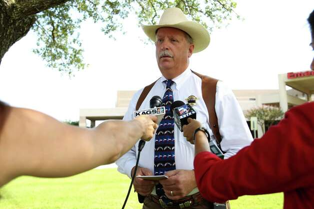 Brazos County Sheriff Chris Kirk speaks to the media outside of the College Station Medical Center, Monday, Aug. 13, 2012, in College Station, where five victims were brought, including Constable Pct. 1's Brian Bachmann, who was killed following a shooting near the Texas A&M campus. Photo: Karen Warren, Houston Chronicle / © 2012  Houston Chronicle