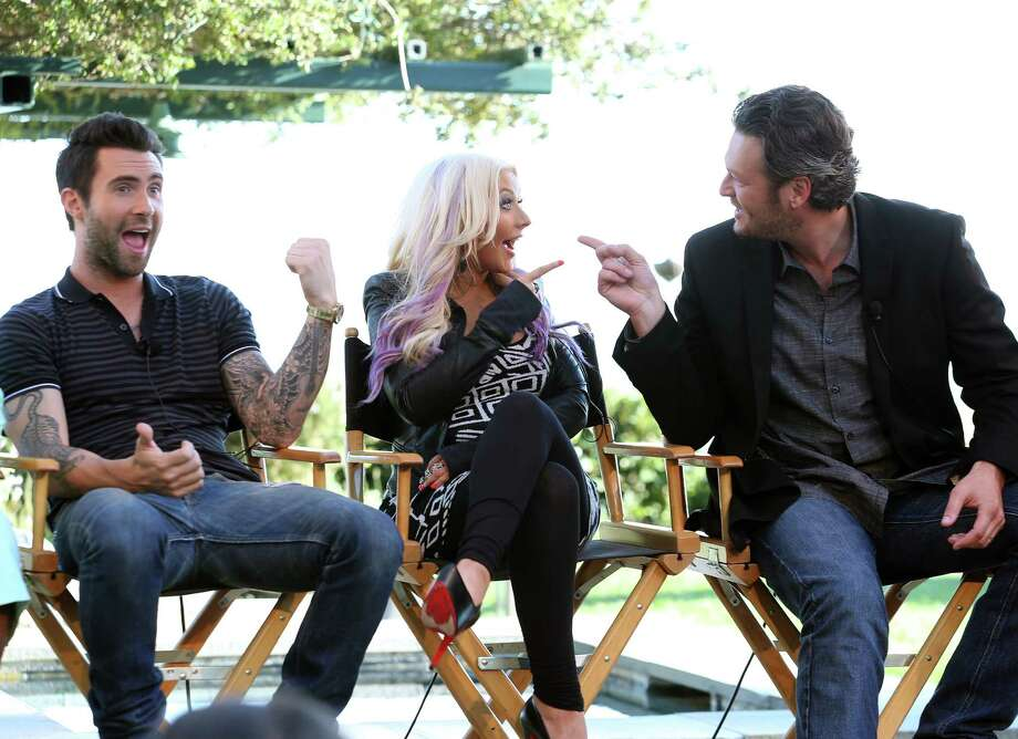 """LOS ANGELES, CA - AUGUST 12:  (L-R) The Voice's Adam Levine, Christina Aguilera, and Blake Shelton speak onstage during the NBCUniversal's """"The Voice"""" Press Junket and cocktail reception on August 12, 2012 in Los Angeles, California.  (Photo by Christopher Polk/Getty Images for NBCUniversal) Photo: Christopher Polk / 2012 Getty Images"""
