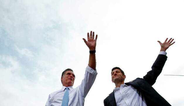 Mitt Romney, left, the presumed Republican presidential candidate, and Rep. Paul Ryan (R-WIs.) on stage during a campaign event in Norfolk, Va., Aug. 11, 2012. Romney introduced Ryan as his running mate Aug. 11, a choice that puts the issue of the nation's fiscal soundness at the center of the presidential race and sharpens the choice facing voters in November. Photo: ERIC THAYER, New York Times / NYTNS