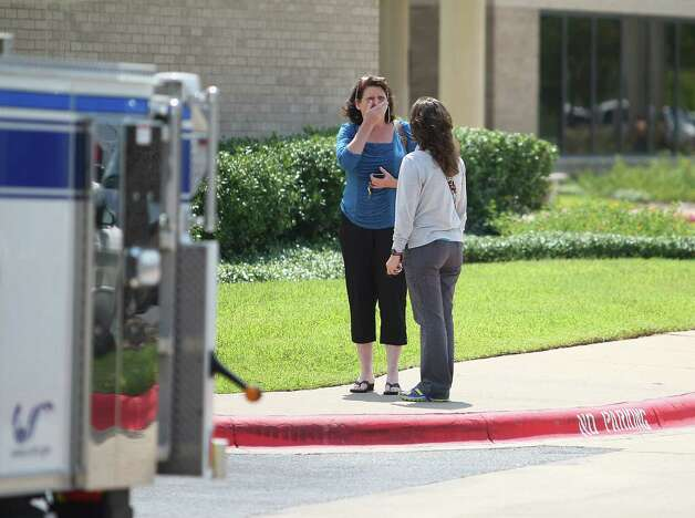 A woman reacts outside of the College Station Medical Center, Monday, Aug. 13, 2012, in College Station, Texas where five victims were brought, following a shooting near the Texas A&M campus. A gunman and a law enforcement officer were among three people killed Monday in a shooting near a Texas university campus, police said. (AP Photo/Houston Chronicle, Karen Warren) Photo: Karen Warren, Associated Press / Houston Chronicle