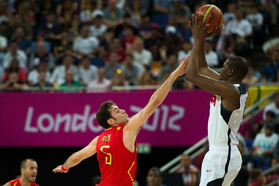 Kevin Durant, shooting over Spain's Rudy Fernandez in the gold-medal game, had to be convinced to let fly by his teammates and coach Mike Krzyzewski. Photo: Smiley N. Pool, Hearst Newspapers
