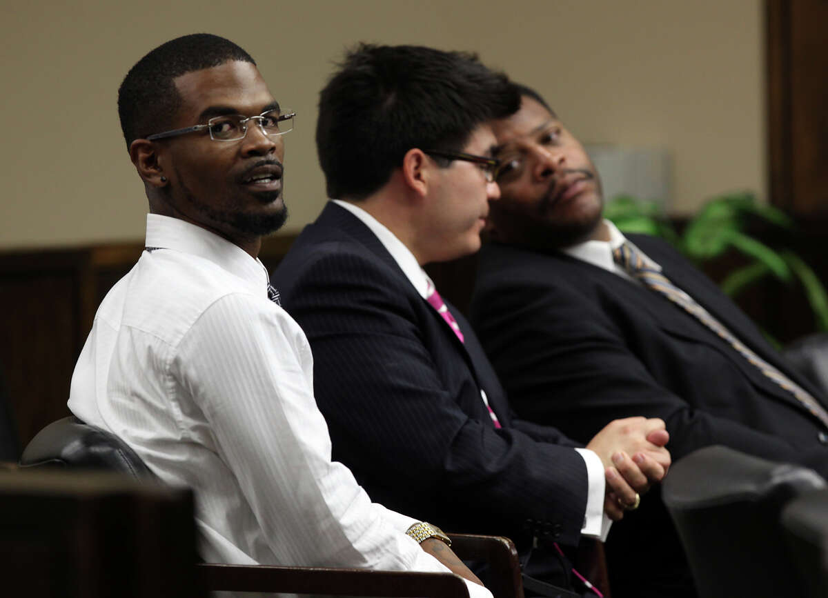 Jeremiah Caprice Coleman, 29, left, sits with attorneys Scott Martinez, center, and Kenneth Bell during a child custody hearing before 57th Judical District Court Judge Antonia Arteaga, Monday, Aug. 13, 2012. Coleman and his girlfriend, Kayela Paige McClintick, (cq). 22, are fighting for custody of her two daughters who were removed by Child Protective Services during an investigation of into child abuse. Coleman and McClintick each face two charges of causing injury to a child. The pair's live-in baby sitter, Joann Denise Brown, 22, faces charges of not reporting the abuse.
