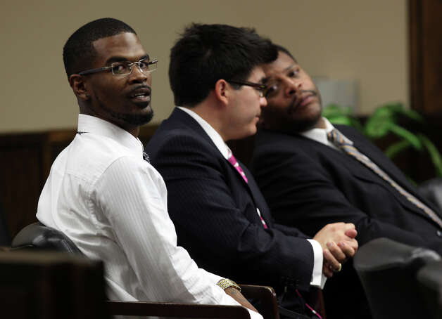 Jeremiah Caprice Coleman, 29, left, sits with attorneys Scott Martinez, center, and Kenneth Bell during a child custody hearing before 57th Judical District Court Judge Antonia Arteaga, Monday, Aug. 13, 2012. Coleman and his girlfriend, Kayela Paige McClintick, (cq). 22, are fighting for custody of her two daughters who were removed by Child Protective Services during an investigation of into child abuse. Coleman and McClintick each face two charges of causing injury to a child. The pair's live-in baby sitter, Joann Denise Brown, 22, faces charges of not reporting the abuse. Photo: Jerry Lara, San Antonio Express-News / © 2012 San Antonio Express-News