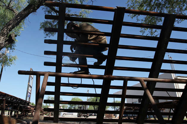 Welder Rick Olveras works on a cattle guard at JV Steel, Inc, in Tilden, Texas, Thursday, August 9, 2012. Once a quiet town along State Highway 16, the McMullen County seat has experience growth due to the Eagle Ford Shale play. Photo: Jerry Lara, San Antonio Express-News / © 2012 San Antonio Express-News