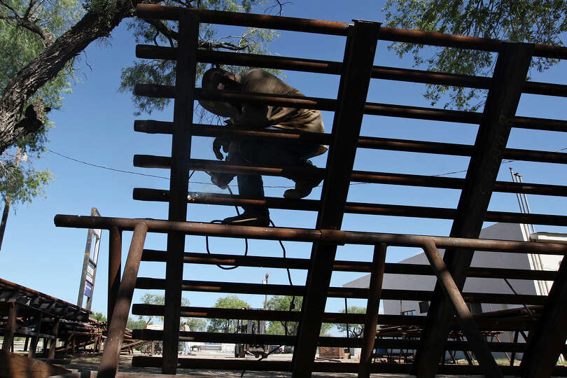 Welder Rick Olveras works on a cattle guard at JV Steel, Inc, in Tilden, Texas, Thursday, August 9,