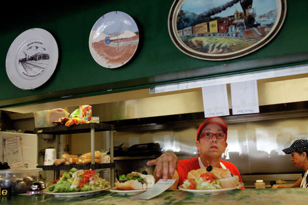 "Mary Rodriguez, the owner of ""Cafe Chris,"" works in the kitchen of her restaurant as the lunch crowd thickens in Pleasanton on Wednesday, August 8, 2012. Photo: Lisa Krantz, San Antonio Express-News / San Antonio Express-News"